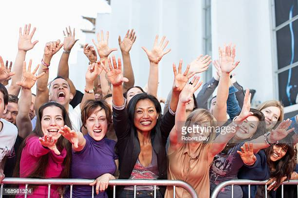 Fans reaching out over barrier