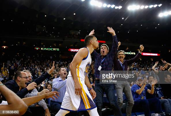 Fans react after Golden State Warriors made a threepoint basket against the New Orleans Pelicans at ORACLE Arena on March 14 2016 in Oakland...