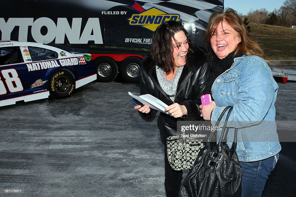 NASCAR fans react after receiving free tickets to a Dover International Speedway race during a Road to Daytona Fueled By Sunoco Tour stop at the Sunoco Station on February 9, 2013 in Newark, Delaware.