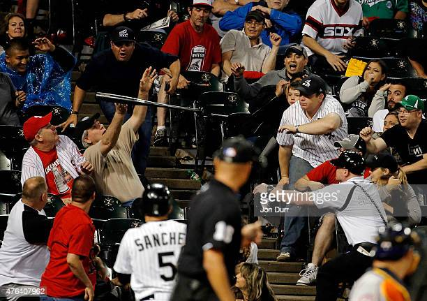 Fans react after the bat of Tyler Flowers of the Chicago White Sox flies into the stands during the game between the Chicago White Sox and the...