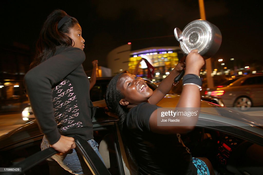 Fans react after the Miami Heat won the NBA title against the San Antonio Spurs June 20, 2013 in Miami, Florida. The Heat won back to back championships.