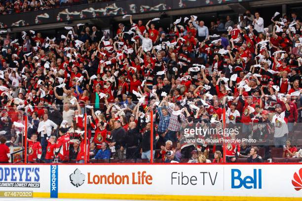 Fans react after the Ottawa Senators scored the game winning goal against the New York Rangers in the third period in Game One of the Eastern...