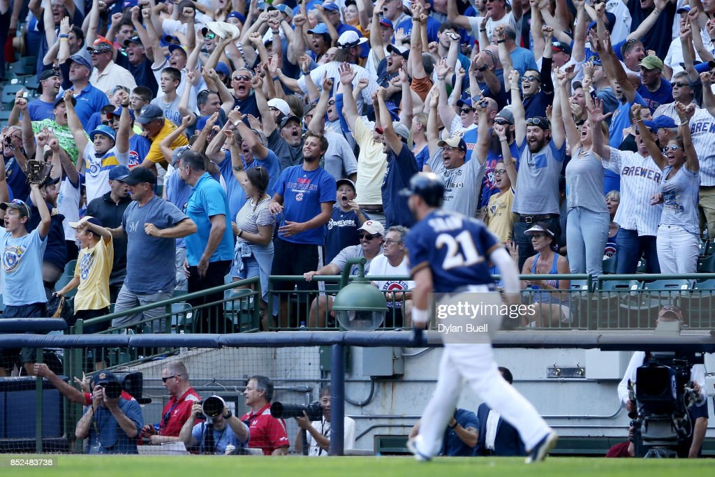 Fans react after Travis Shaw #21 of the Milwaukee Brewers hit a walk off home run to beat the Chicago Cubs 4-3 in ten innings at Miller Park on September 23, 2017 in Milwaukee, Wisconsin.