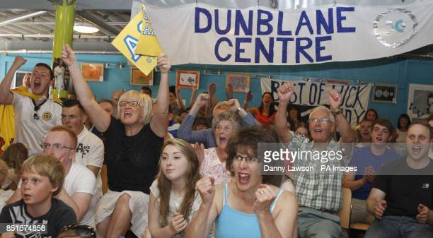 Fans react as Andy Murray wins the 1st Set of the Wimbledon final on a screen at the Dunblane Centre in Andy Murray's home town of Dunblane in...