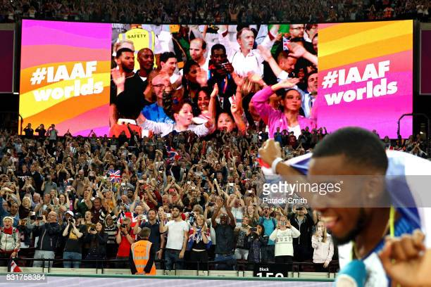 Fans react as Chijindu Ujah Adam Gemili Daniel Talbot and Nethaneel MitchellBlake of Great Britain celebrate winning gold in the Men's 4x100 Relay...