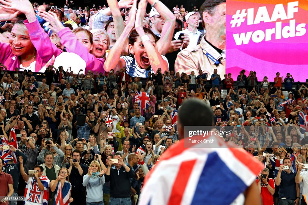 Fans react as Chijindu Ujah, Adam Gemili, Daniel Talbot and Nethaneel Mitchell-Blake of Great Britain celebrate winning gold in the Men's 4x100 Relay final during day nine of the 16th IAAF World Athletics Championships London 2017 at The London Stadium on August 12, 2017 in London, United Kingdom.