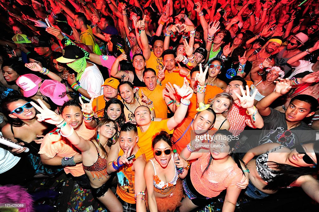 Fans react as DJ/producer Laidback Luke performs at the 17th annual Electric Daisy Carnival at Las Vegas Motor Speedway on June 24, 2013 in Las Vegas, Nevada.