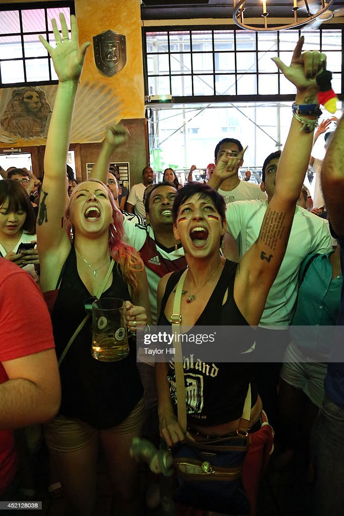 Fans react as Germany scores during the 113th minute of the 2014 FIFA World Cup final at the German beer garden Reichenbach Hall on July 13, 2014 in New York City.