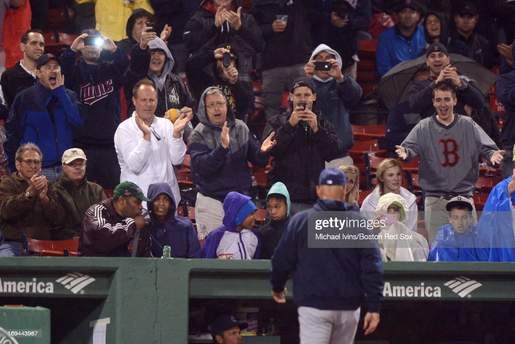 Fans react as manager <a gi-track='captionPersonalityLinkClicked' href=/galleries/search?phrase=Terry+Francona&family=editorial&specificpeople=171936 ng-click='$event.stopPropagation()'>Terry Francona</a> #17 of the Cleveland Indians heads back to the dugout after a pitching change against the Boston Red Sox in the seventh inning on May 24, 2013 at Fenway Park in Boston, Massachusetts.