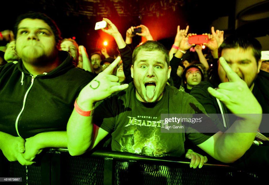 Fans react as Megadeth performs at the Myth Nightclub on November 23, 2013 in St. Paul, Minnesota. It was their first stop as part of their new Super Collider Tour.
