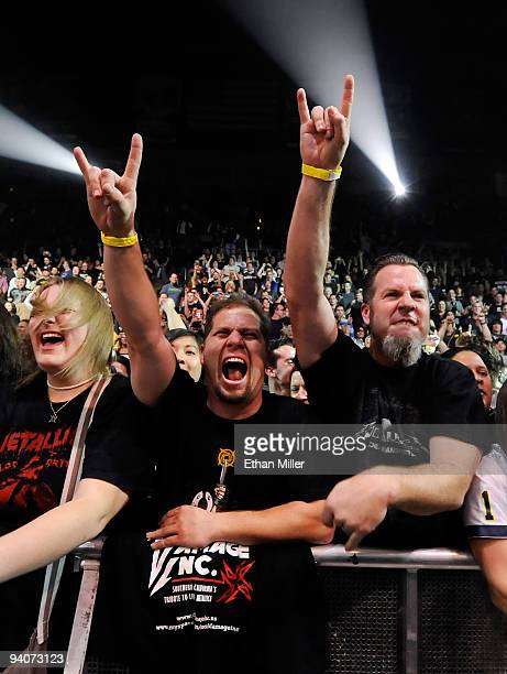 Fans react as Metallica performs during a soldout concert at the Mandalay Bay Events Center December 5 2009 in Las Vegas Nevada The band is touring...