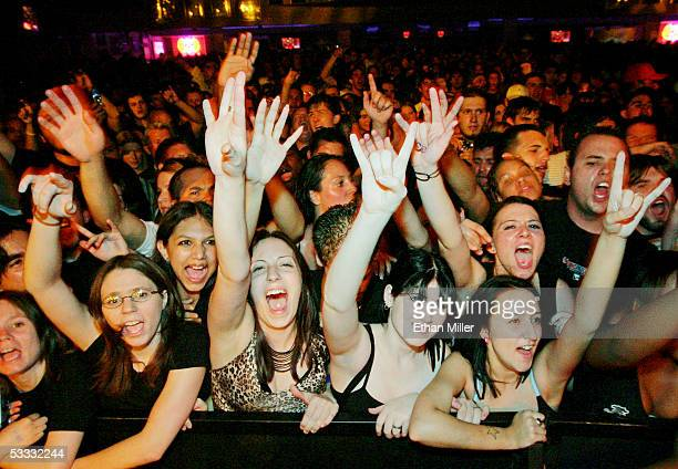 Fans react as Papa Roach performs at The Joint inside the Hard Rock Hotel Casino August 5 2005 in Las Vegas Nevada The rock group is touring in...
