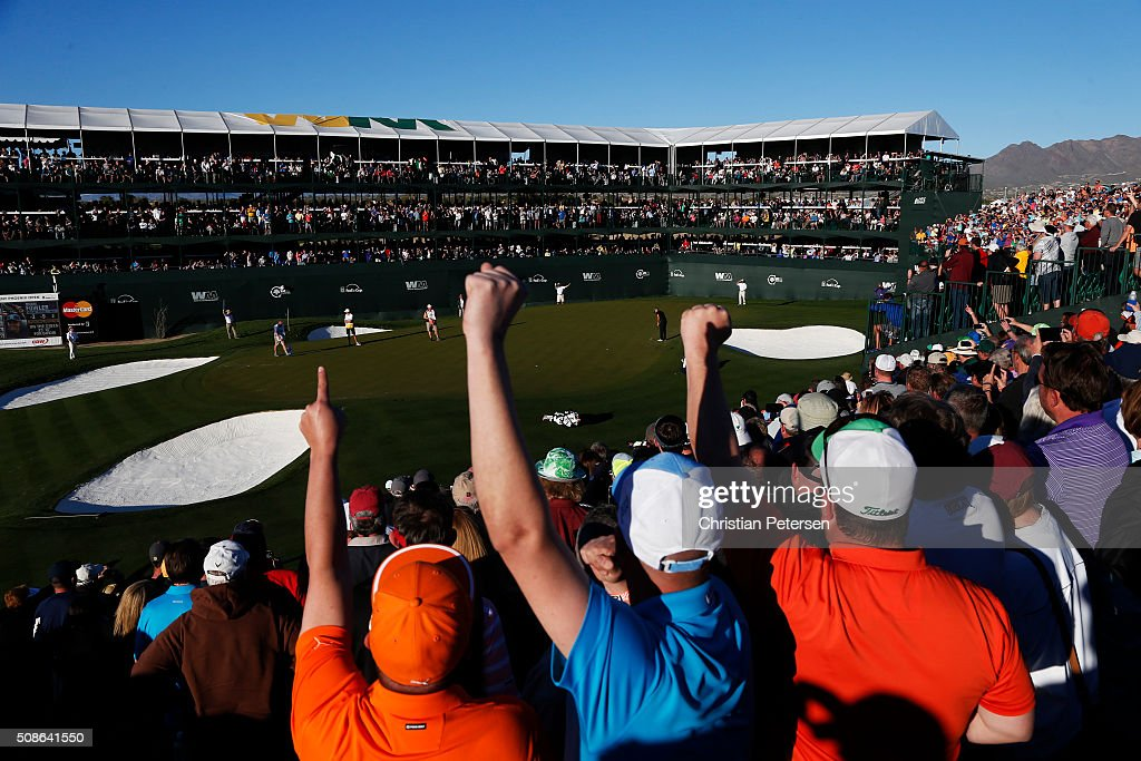 Fans react as Rickie Fowler putts on the 16th green during the second round of the Waste Management Phoenix Open at TPC Scottsdale on February 5, 2016 in Scottsdale, Arizona.