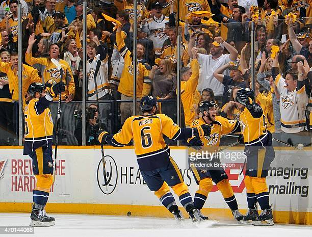 Fans react as Roman Josi of the Nashville Predators is congratulated by teammates Shea Weber Calle Jarnkrok and Vicktor Stalberg after scoring a goal...