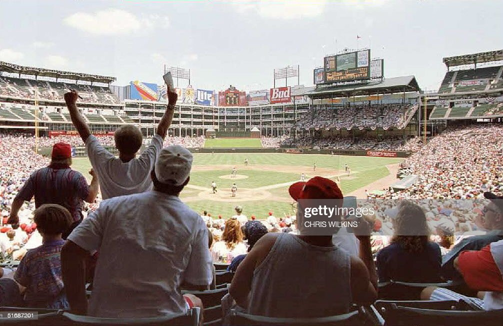 Fans react as Texas Ranger Juan Gonzalez hits a home run against the New York Yankees 09 July during the final game before the All Star break at the...