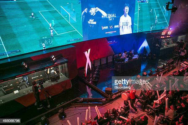 Fans react as they watch the final round of the Electronic Arts Inc Sports FIFA Online Championship at the Nexon Co eSports Stadium in Seoul South...
