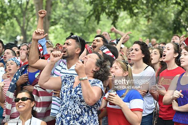 US fans react as they watch the US play Germany in a 2014 FIFA World Cup Group G match at Dupont Circle in Washington on June 26 2014 AFP...