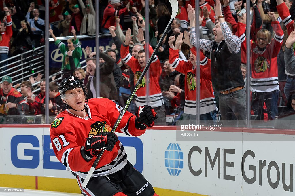 Fans react behind <a gi-track='captionPersonalityLinkClicked' href=/galleries/search?phrase=Marian+Hossa&family=editorial&specificpeople=202233 ng-click='$event.stopPropagation()'>Marian Hossa</a> #81 of the Chicago Blackhawks after he scored on the Philadelphia Flyers in the first period of the NHL game at the United Center on March 16, 2016 in Chicago, Illinois.