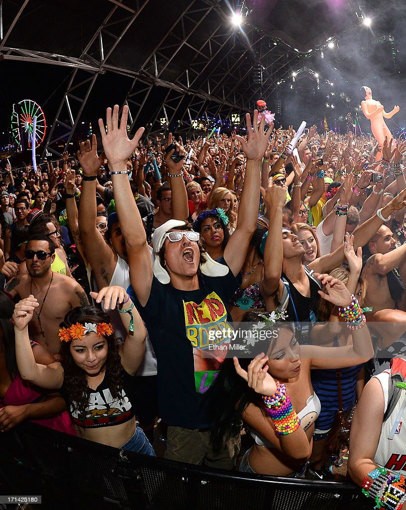 Fans react during a performance by DJs AN21 and Max Vangeli at the 17th annual Electric Daisy Carnival at Las Vegas Motor Speedway on June 23, 2013 in Las Vegas, Nevada.