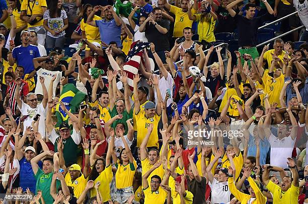 Fans react during an international friendly between the United States and Brazil at Gillette Stadium on September 8 2015 in Foxboro Massachusetts