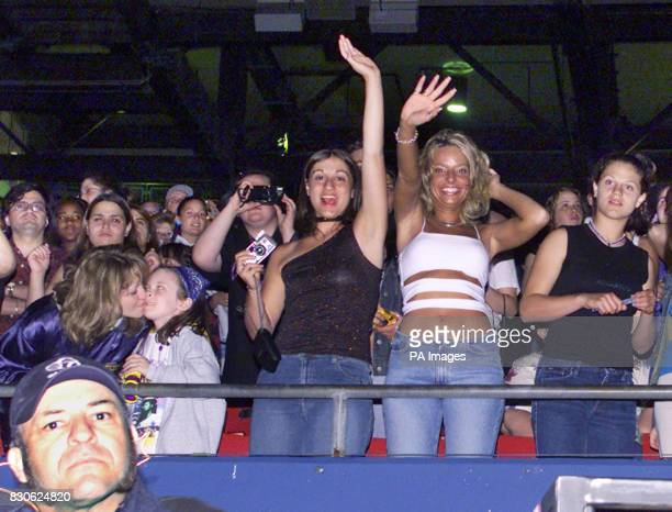 Fans react during the opening act of the NSync concert at Giants Stadium in East Rutherford New Jersey June 3 2001