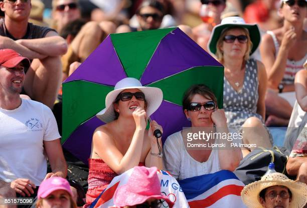 Fans react on Murray Mount as they watch Great Britain's Andy Murray play Serbia's Novak Djokovic in their Men's Final on the big screen during day...