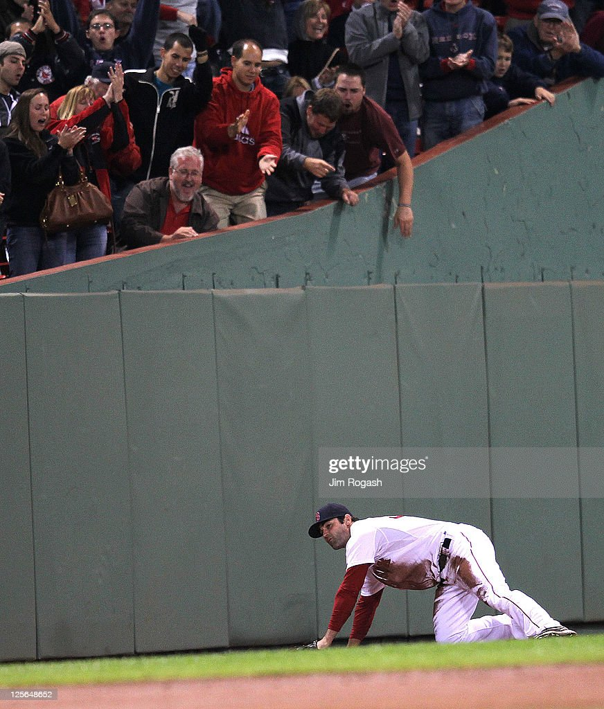 Fans react to a diving catch by <a gi-track='captionPersonalityLinkClicked' href=/galleries/search?phrase=Conor+Jackson&family=editorial&specificpeople=593147 ng-click='$event.stopPropagation()'>Conor Jackson</a> #36 of the Boston Red Sox in the second game of a doubleheader against the Baltimore Orioles at Fenway Park September 19, 2011 in Boston, Massachusetts.