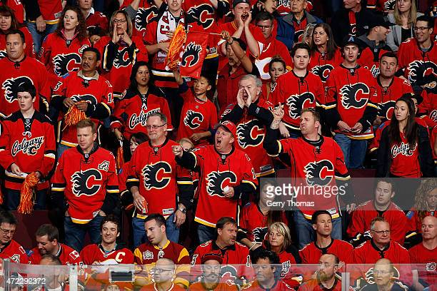 Fans react to a nogoal decision during the game between the Calgary Flames skates and the Anaheim Ducks at Scotiabank Saddledome for Game Three of...