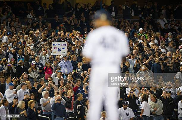 Fans react to Mariano Rivera of the New York Yankees entering the game in the top of the eighth inning during the game against the Tampa Bay Rays on...