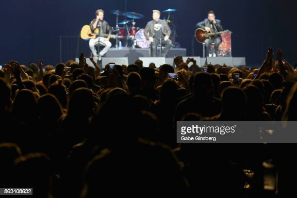 Fans react to recording artists Joe Don Rooney Gary LeVox and Jay DeMarcus of Rascal Flatts performance during 'Vegas Strong A Night of Healing' at...