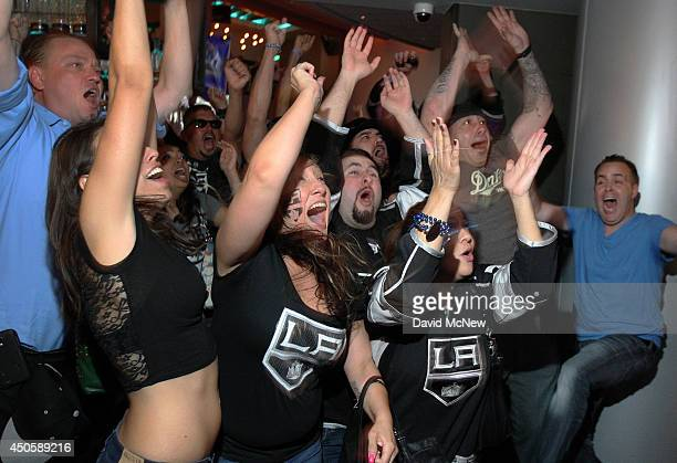 Fans react to the winning goal as the Los Angeles Kings beat the New York Rangers to win the Stanley Cup on June 13 2014 in Los Angeles California It...