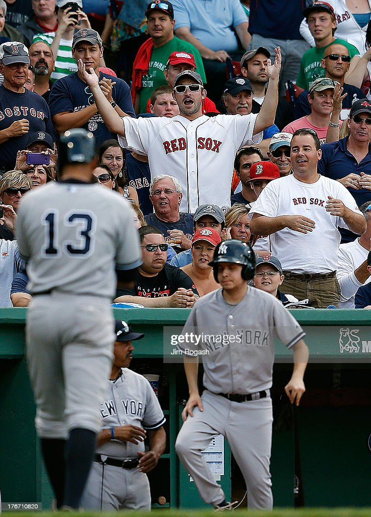 Fans reacts as Alex Rodriguez #13 of the New York Yankees walks back to the dugout out during the game against the Boston Red Sox at Fenway Park on August 17, 2013 in Boston, Massachusetts.