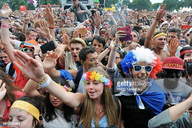 Fans reacts during the concert of the French rap band Bigflo Oli on July 18 2015 in CarhaixPlouguer western France on the third day of the Vieilles...