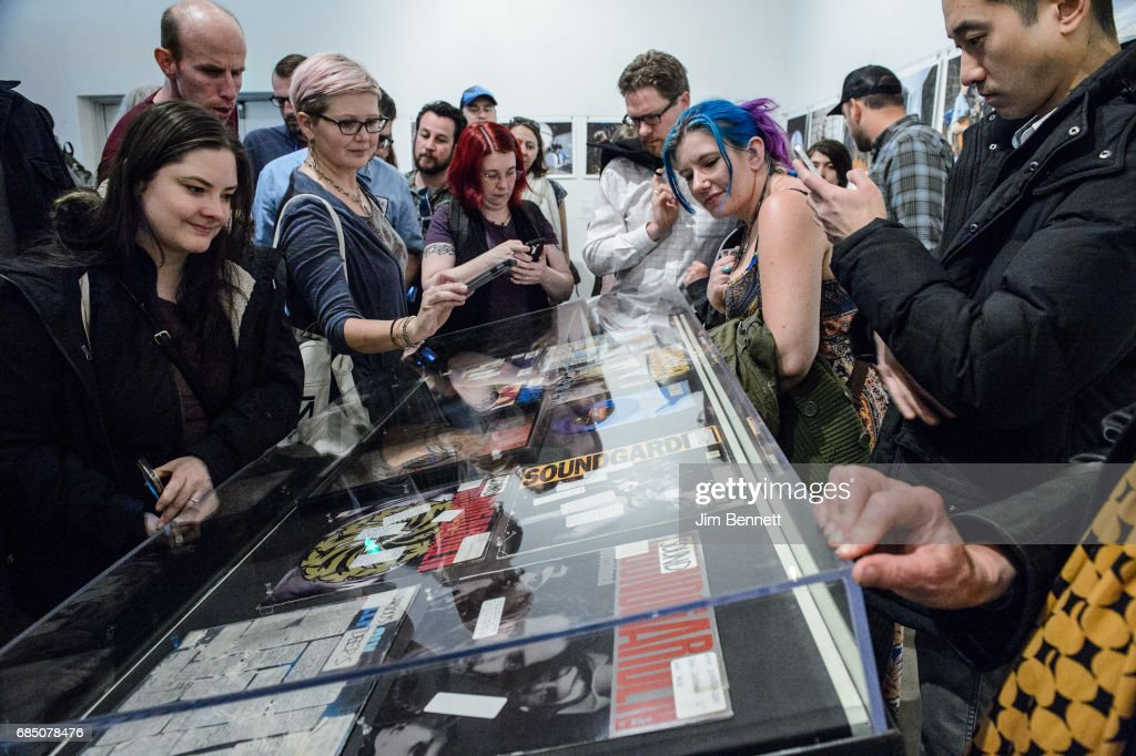 Fans read DJ comments written on vinyl records on display at a memorial for Chris Cornell held at radio station KEXP on May 18, 2017 in Seattle, Washington. Cornell, of the bands Soundgarden and Audioslave, died unexpectedly on Wednesday. He was 52 years old.