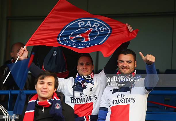PSG fans ready their flags ahead of the UEFA Champions League Quarter Final second leg match between Chelsea and Paris SaintGermain FC at Stamford...