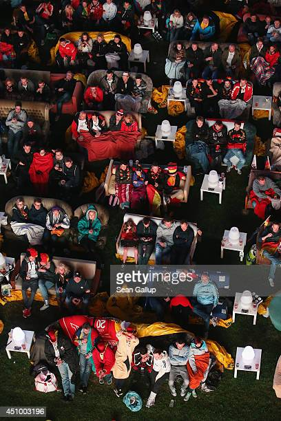 Fans reclining on sofas watch the GermanyGhana World Cup match at a public viewing at the Alte Foersterei FC Union stadium on June 21 2014 in Berlin...