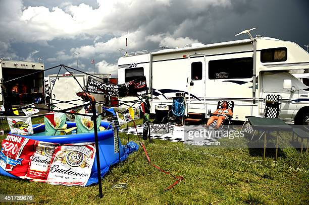 Fans relax in the infield prior to the NASCAR Sprint Cup Series Coke Zero 400 at Daytona International Speedway on July 5 2014 in Daytona Beach...