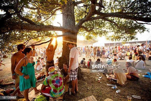 Fans relaxing at sunset during Bonnaroo Music and Arts Festival