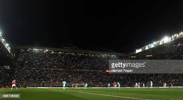 Fans remember George Best by shining lights during the UEFA Champions League Group B match between Manchester United FC and PSV Eindhoven at Old...