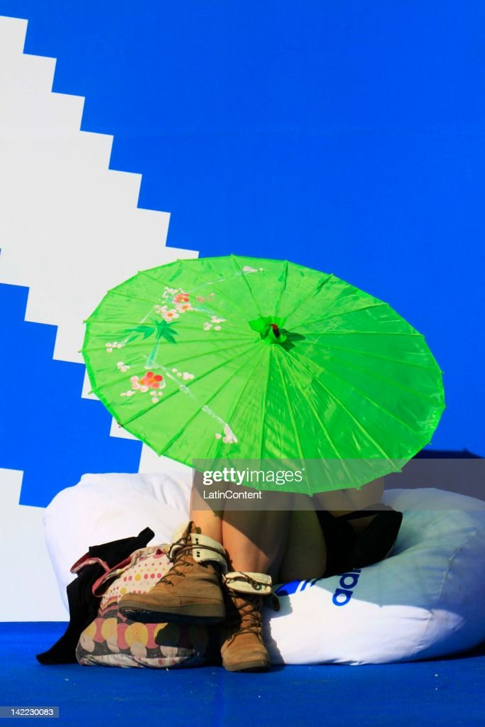 A fans rest in the Lollapalooza music festival at O Higgins Park on March 31, 2012 in Santiago, Chile.