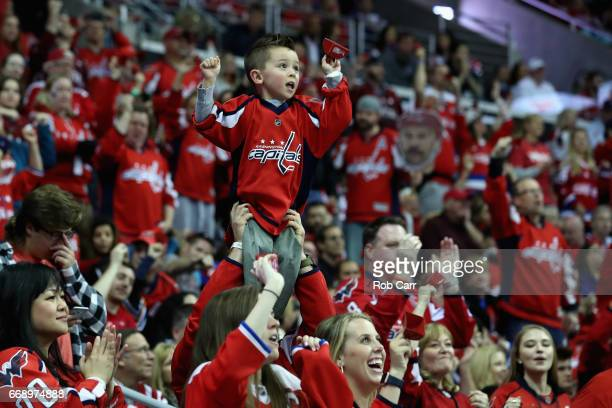Fans ring cowbells during overtime of the Washington Capitals and Toronto Maple Leafs game in Game Two of the Eastern Conference First Round during...