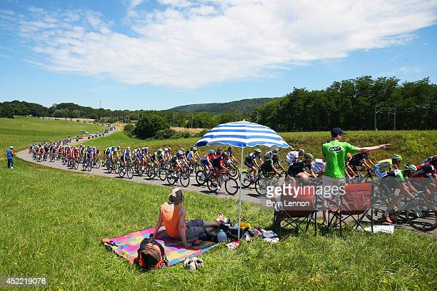 Fans roadside enjoy the atmosphere as the peloton passes by during the eleventh stage of the 2014 Tour de France a 188km stage between Besancon and...