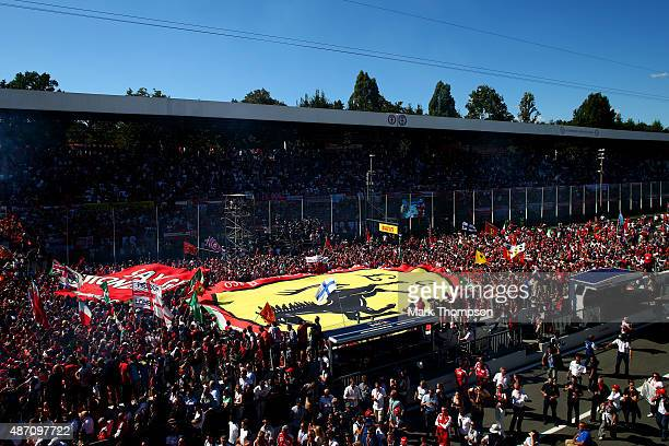 Fans run down the pit straight after the Formula One Grand Prix of Italy at Autodromo di Monza on September 6 2015 in Monza Italy