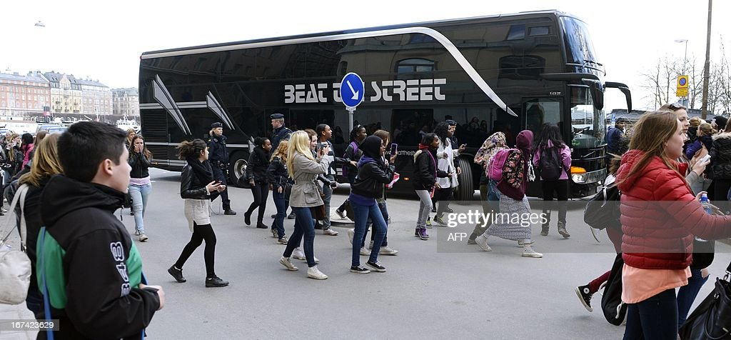 Fans run toward the tour bus of Canadian pop singer Justin Bieber in Stockholm on April 23, 2013. A spokesperson for the Swedish police told AFP on April 25, 2013 that they had found a 'small amount' of drugs on Justin Bieber's tour bus in Stockholm, though no suspect has been identified.