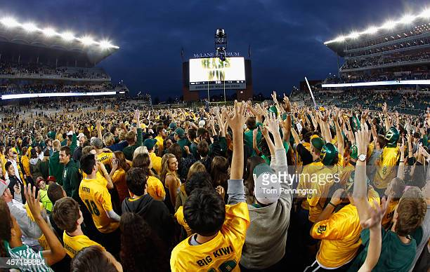 Fans rush the field after the Baylor Bears beat the TCU Horned Frogs 6158 at McLane Stadium on October 11 2014 in Waco Texas