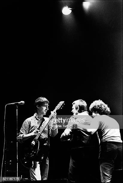 Fans rush the stage to touch Paul Weller of The Jam as he performs on stage at the Rainbow Theatre London 15 November 1980