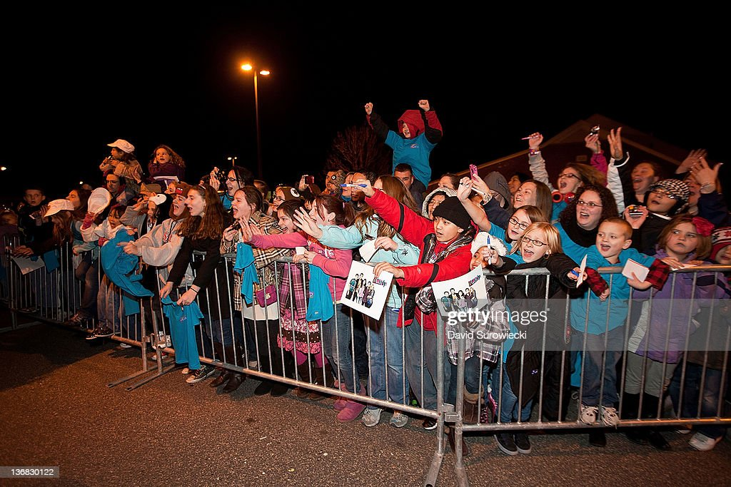 Fans scream as the cast of iCarly leaves the auditorium at Naval Submarine Base New London on January 11, 2012 in Groton, Connecticut. The cast of iCarly was presenting a special military family screening of iMeet The First Lady, an episode of their show featuring Michelle Obama.