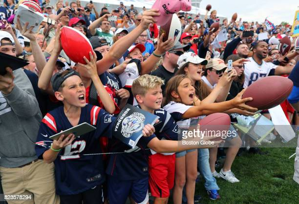 Fans scream for autographs from New England Patriots Rob Gronkowski after the first day of training camp at the Gillette Stadium practice field in...