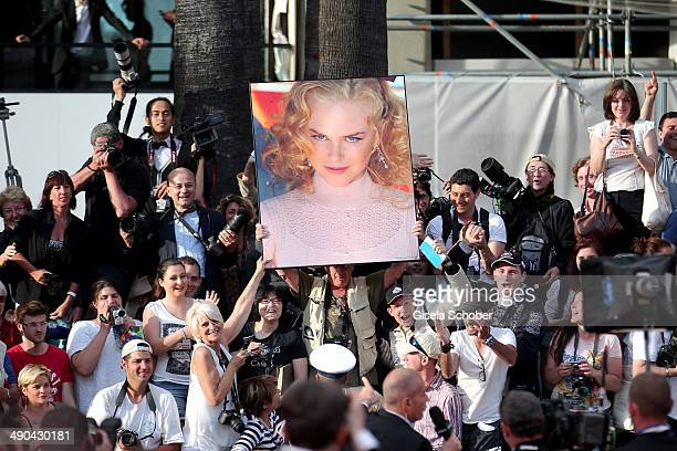 Fans seen with a picture of actress Nicole Kidman during the Opening ceremony and the 'Grace of Monaco' Premiere during the 67th Annual Cannes Film...