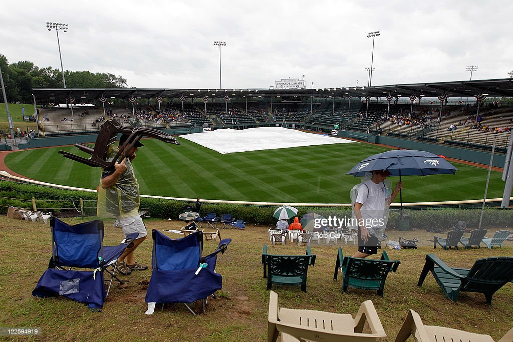 Fans set up chairs in center field during a rain delay before the start of the Little League World Series championship game between the Japan team from Hamamatsu City, Japan and the West team from Huntington Beach, California on August 28, 2011 in South Williamsport, Pennsylvania.